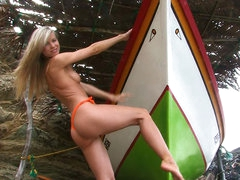 Marketa stands naked by boat