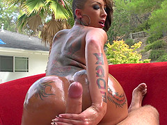 Bella Bellz gets her oiled tattooed..