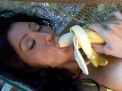 Playboy beauty lustily eats banana