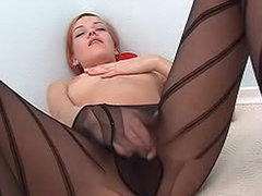 Masturbating in her sheer black pantyhose