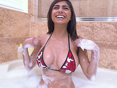 Mia Khalifa kneads her big tits in a..