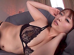 Lovely Japanese milf poses nasty in a..