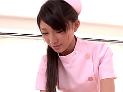 Skinny Japanese nurse with small tits..
