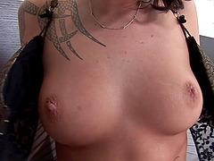 Tattooed brunette with a hot ass..