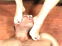 Foot domination porn along a blonde slut
