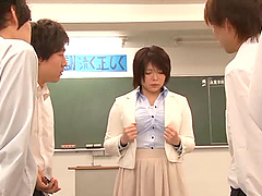 Busty Japanese teacher gets naked at..