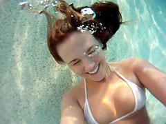 Roxy Raye wearing a bikini shows her..