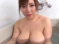 Japanese babe with big tits gives..
