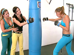 Three sporty lesbian girls having fun in gym