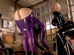 Two babes in latex outfits have a..