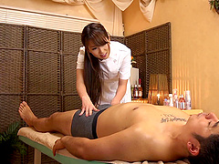 Long haired Asian masseuse in uniform..