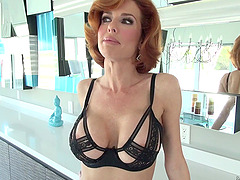 Immaculate redhead milf with a shaved..