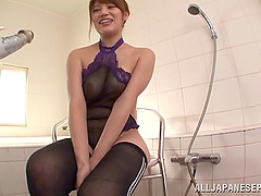 A horny Asian MILF probes her tight..