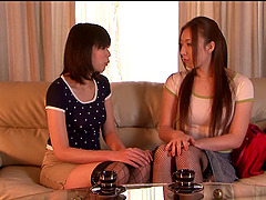 Two Asian lesbians lick pussies in 69..