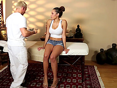 Masseur turns on the busty chick and..