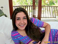 Fabulous brunette teen with long hair..