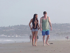 Young couple takes a walk on the beach..