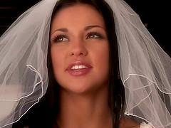 A bride leaves her veil on while..