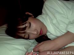 He wakes his sleeping Asian girlfriend..