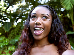 Breathtaking ebony teen giving a..