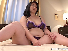 A Japanese BBW relaxes on her bed..
