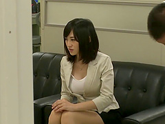 Busty Asian office babe in black skirt..