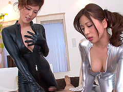 Shiny catsuits look smoking hot on a..