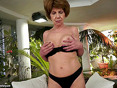 Granny dazzles in her stockings as she..