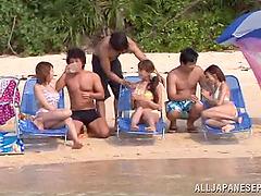 Beach orgy on a sunny day with a bunch..