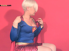 Supergirl wears her nylons and flexes..