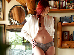 Curvy redhead with awesome juggs..