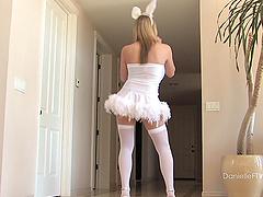 Kinky blonde wearing playboy costumes..