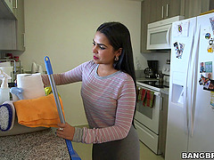 This busty Latina maid cleans in the..