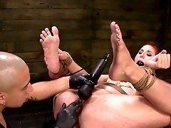 Rough bondage with a sleazy redhead