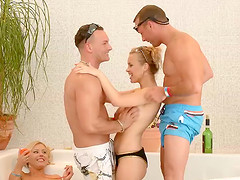 Four horny people playing a sex game..