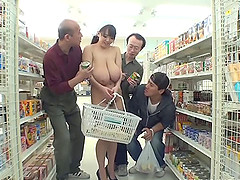 A wild, busty Japanese girl shops nude..