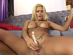 She puts a candle then a stiff cock..
