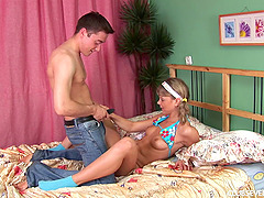 Dainty teen with pigtails shows off..