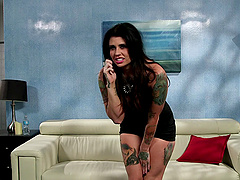 Tattooed punk girl makes a booty call..