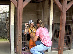 Caged girl services her master with a..
