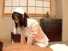 A dedicated Asian nurse uses her..