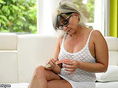 Chubby mature blonde in glasses..