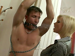 Sexy dominatrix with short blonde hair..