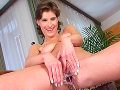 Susane pumps her shaved pussy and..