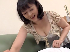 Mature Japanese Hitomi Enjou favours a..