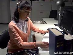 Mature Japanese teacher touching her..