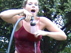 Outdoors with the hose is curvy girl..