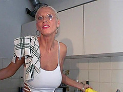 Tattooed granny with glasses sucking a..