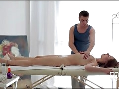 Masseur erotically works fingers into..