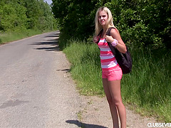 Teen blonde hitchhiker takes a break..
